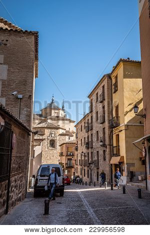 Toledo, Spain - October 13, 2017: Picturesque View Of Street In Toledo Old Town With San Marcos Chur