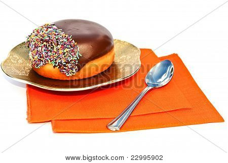 Chocolate Doughnut  On A Golden Plate