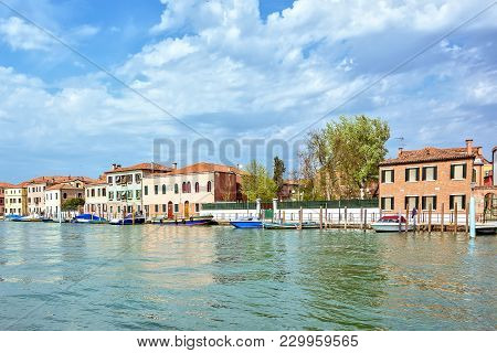 Daylight View To Venetian Lagoon Canal With Parked Boats
