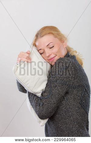 Sleep Time, Warm Bedding, Tiredness Concept. Happy Sleepy Tired Woman Smiling And Holding Cozy White