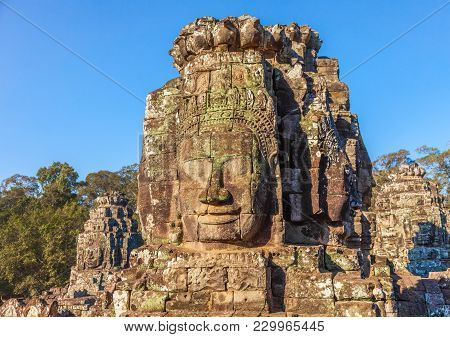 Bayon Temple Smailing Faces At The Center Of Angkor Thom Ancient Khmer Empire. Tourist Travel Landma