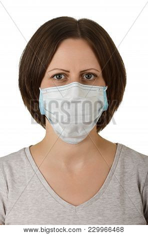 Woman In Disposable Medical Protective Mask Isolated On White Background