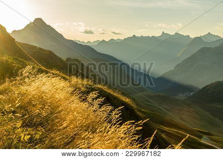 Amazing Sunrise And Layered Mountain Silhouettes In Early Morning Light. Lechtal And Allgau Alps, Ba