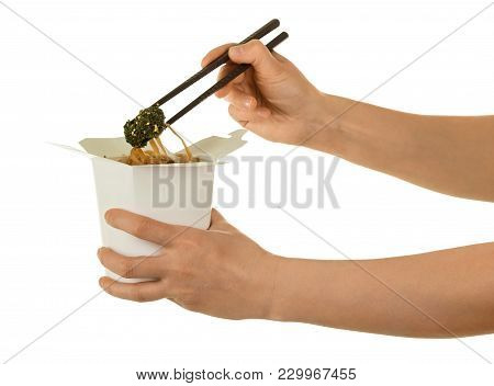 Female Hand Takes Of Sticks, Spicy Chinese Noodles From Wok Box, Isolated On White Background