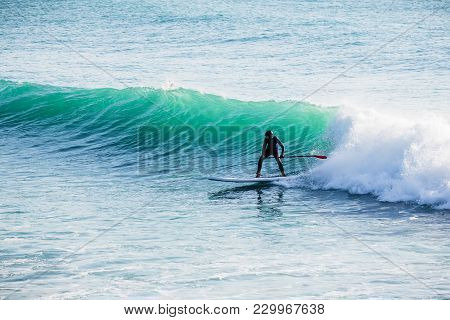 Surfer Ride On Stand Up Paddle Board On Ocean Waves. Stand Up Paddle Boarding In Ocean