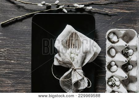 Natural Easter Table Decoration With Silverware And Egg Box With Willow On Old, Black Wooden Table