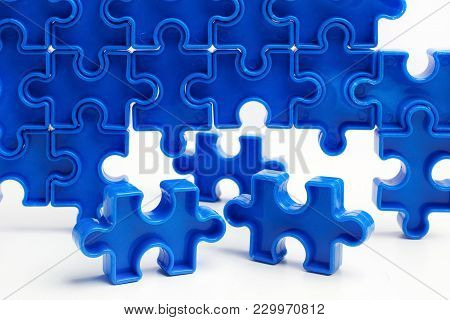 Pieces From A Blue Jigsaw Puzzle Arranged To Form A Page On White Background. Break Barriers Togethe
