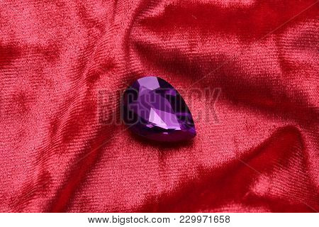 Precious stone for jewellery on red velvet
