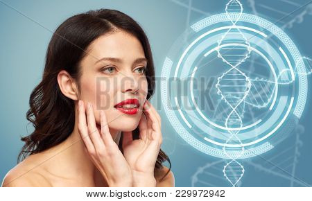 beauty, genetics and people concept - happy smiling young woman with red lipstick over blue background and dna molecule hologram