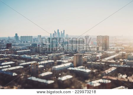True Tilt-shift View Of Autumn Or Spring Cityscape With Skyscrapers And Residential Houses, With Foc
