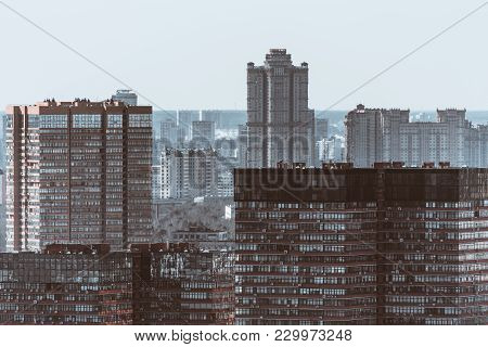 Close-up Urban View Of Multiple Office Buildings And Residential Houses, Facades With Many Windows A
