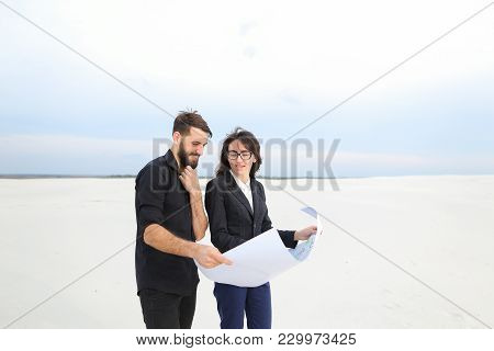Deputy Female And Architect Male Meet To Discuss Stadium In Countryside, People Standing In Deserted