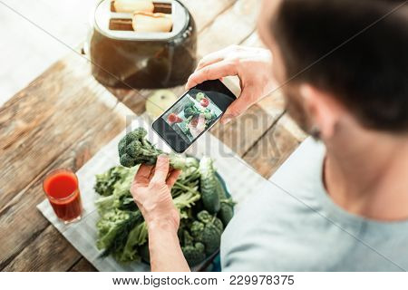 I Will Remember. Useful Ergonomic Cellphone Making Photo Being Above Vegetables.