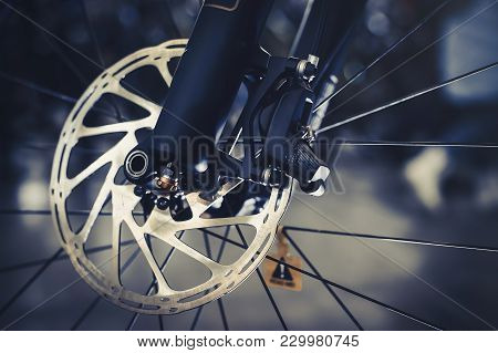 Mountain Bike Front Wheel With Mechanical Disc Marriage. Part Of Mountain Bike Brake In Close Up