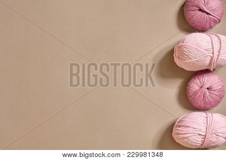 Pink Knitting Yarn Balls On A Beige Background. Top View. Copy Space. Still Life. Flat Lay