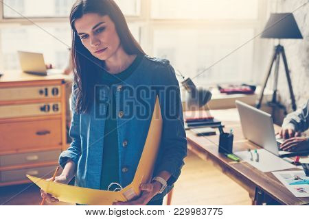 Loft Office Work Process. Young Woman With Paperwork Standing In Open Space. Film Effect