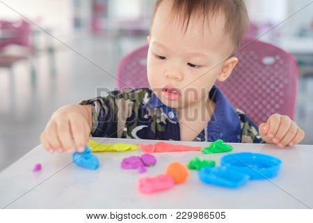 Cute Little Asian 18 Months Old Toddler Baby Boy Child Having Fun Playing Colorful Modeling Clay / P