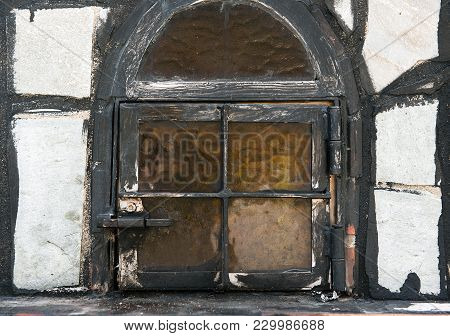 A Closed Old Grunge Window With Yellow Glass, Closeup