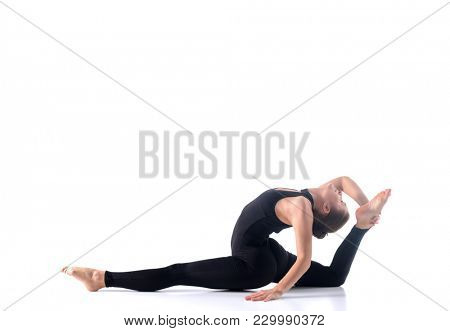 Sporty young woman doing yoga practice isolated on white background - concept of healthy life