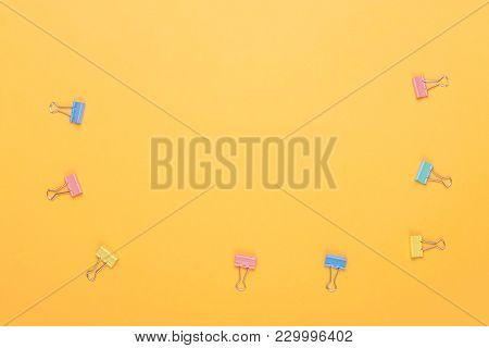 Yellow Background With Colorful Paper Clip Holders. With Your Place For The Text.