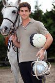 A young horseback rider poster