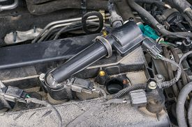 Ignition Coil And Spark Plugs Of An Old Dirty Car Needing Change