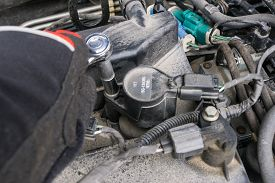Removing Ignition Coil And Spark Plugs Of An Old Dirty Car Needing Change
