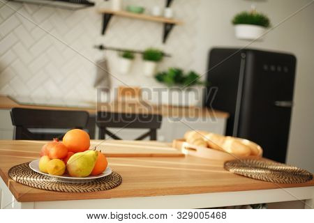 Background Of Modern Kitchen Interior With Food Fruits Products On Wooden Table