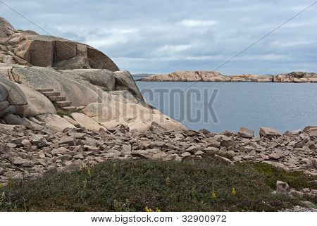 Stones at the red granite coast on the Swedish west coast. poster