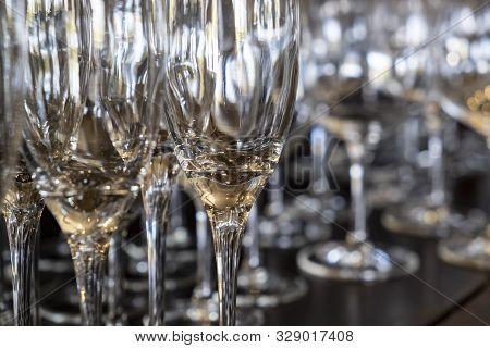Closeup Of Empty Wine Glasses In Various Shapes On A Bar Table