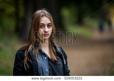 Teenager. Young Beautiful White Caucasian Addict Teenage Girl With Unwashed Hair And Bruises Under T
