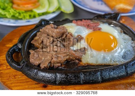 Sizzling Beef Steak Served With Sunny Egg And Salad