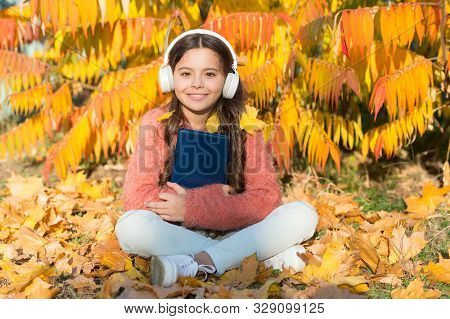 Music Is Universal Language. Happy Small Child Listen To Audio Language Course. Little Girl With Aud
