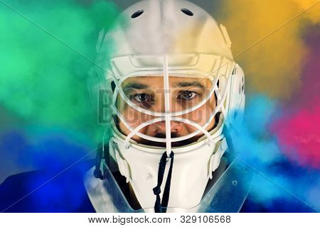 Detail Of A Male Face In A White Goalie Hockey Mask And  Colored Smoke.this Is A Detail Hockey Goali