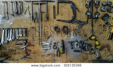 Keys In The Garage Tools. Old Tools Hanging On Wall In Workshop , Tool Shelf Against A Wall In The G