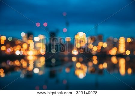 Oslo, Norway. Night Abstract Boke Bokeh Background Effect. Design Backdrop. Night View Embankment An