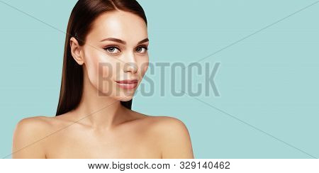 Beautiful Spa Model With Brown Hair And  Clean Fresh Skin Portrait. Skin Care, Beauty Treatment And