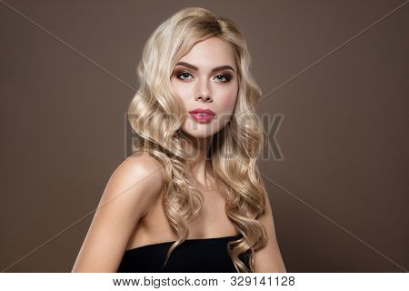 Attractive Woman. Blonde Haired Model Portrait With Blue Eyes And Healthy Long Shiny Wavy Hairtyle.