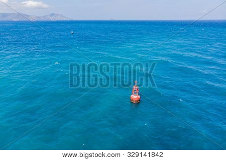 Floating Red Navigational Buoy On Blue Sea, Gulf. Drone