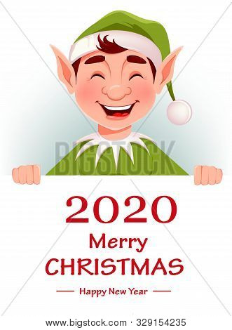Merry Christmas Greeting Card With Funny Elf. Santa Claus Helper Elf Standing Behind White Placard W