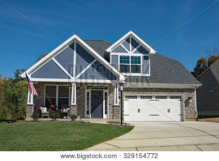 New American Stone Home with Blue Decorative Gables