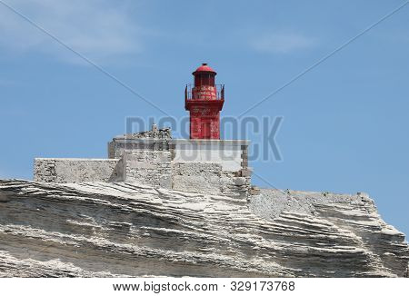 Small Red Lighthouse Near Bonifacio City In Corsica France On The Rocks
