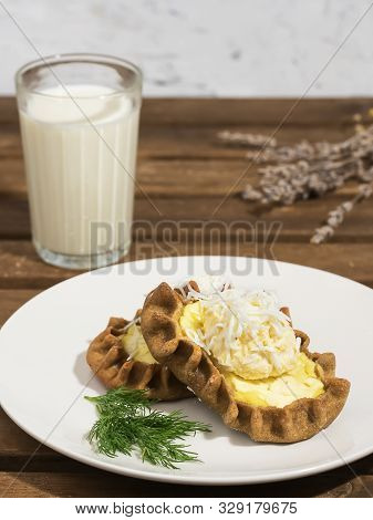 Karelian Pirakka Pies Located On A White Plate. Near A Glass Of Milk, A Branch Of Lavender. Traditio