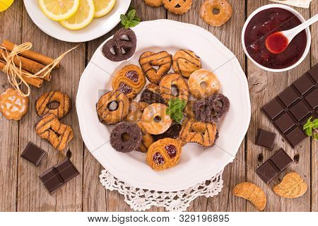 Shortcrust pastry biscuits for teatime on white dish. poster