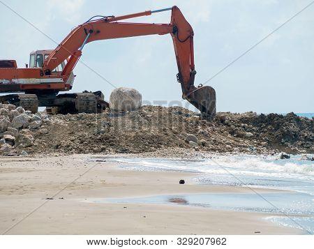 Excavator Digger Stone Working On Construction Site - Backhoe Loader On Beach Sea Ocean. Excavator D