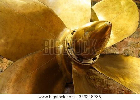 Bronze six bladed propeller screw of a boat or ship. The brass ship screw propeller helps in ship navigation