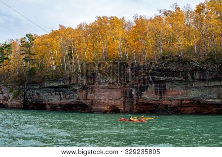 Kayakers Make Their Way Through The Sea Caves At The Apostle Islands National Lakeshore In Wisconsin