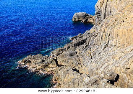 Wild Rocky Beach Near Manarola In Cinque Terre, Italy