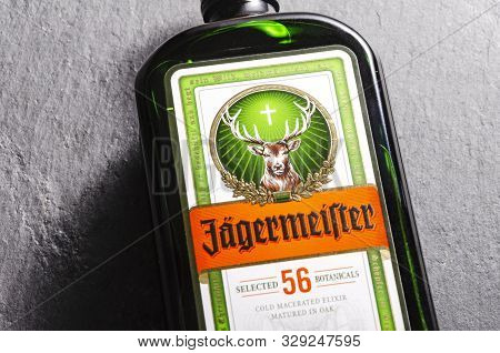 Jagermeister Digestif On Stone Slate Background. Jagermeister Made With 56 Herbs And Spices. It Is M