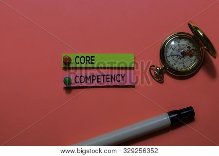 Core Competency Write On Sticky Notes. Isolated On Pink Table Background